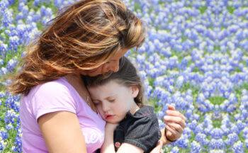 mother hugging her daughter