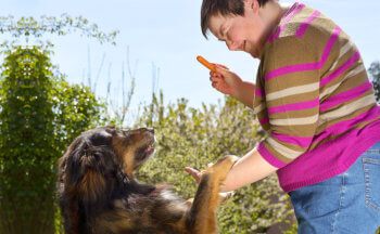 disabled woman happy with her dog